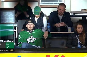 Luka Doncic takes in a Stars - Kings game