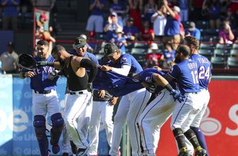 Rangers score 2 runs in 10th, rally past Cardinals 5-4