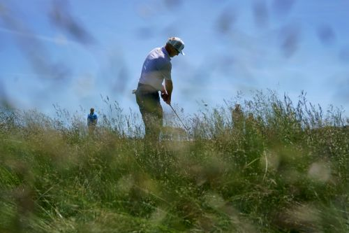 Ian Poulter shows how difficult U.S. Open rough is