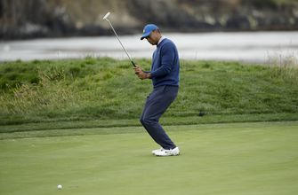 The Latest: Woods opens third round with bogey