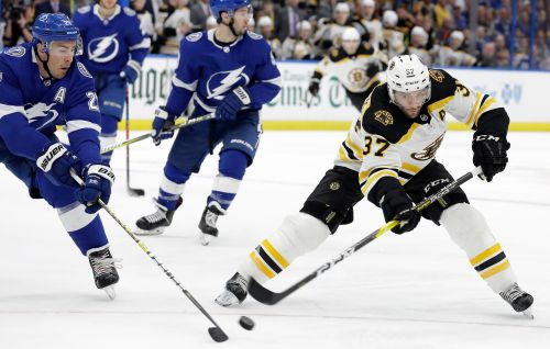 NHL win record in sight as Lightning rally past Bruins for 59th victory of season