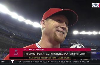 Kole Calhoun called on higher powers to help him with 9th inning putout at home