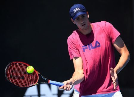 American number one Isner toppled by taller Opelka