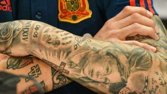 Toe Poke Daily: Sergio Ramos' tattoos: stuffed rabbit, a football pitch, tribute to Banksy