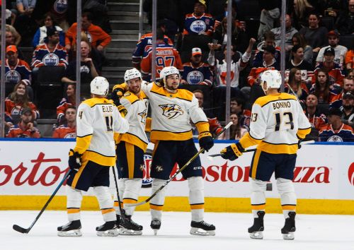 Coach lightens Preds' mood, wears bull's head for road wins