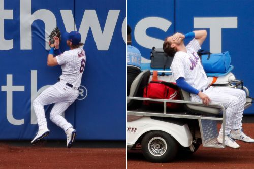 Mets' Jeff McNeil carted off after crashing into wall making catch