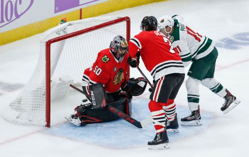 Crawford registers 39 saves, Blackhawks beat Wild 3-1