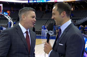 Chris Holtmann talks with Nick Bahe after Ohio State's comeback win over Creighton