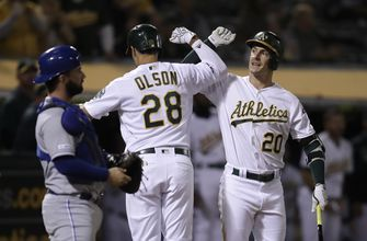 Olson's deep homer helps A's rally late to beat Royals 2-1