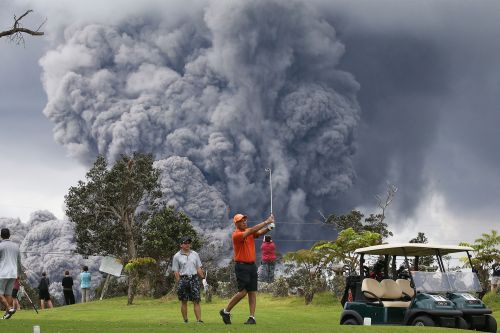 Photographer shocked to find golfers near erupting volcano