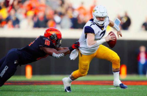 Oklahoma State puts serious dent in West Virginia's Playoff and Heisman hopes with big upset
