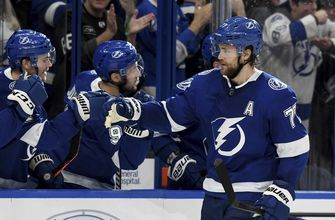 Lightning clinch Presidents' Trophy; Canucks win in OT