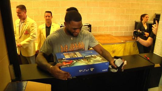 UCF football players celebrate receiving PlayStation 4 consoles from Fiesta Bowl