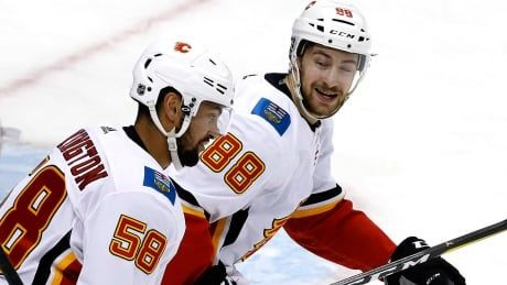 Flames' checking forwards fill scoresheet to beat Penguins