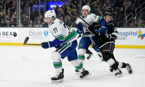 Canucks rally to beat Kings 4-3, end road losing streak at 4