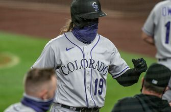 Rockies late power surge gives them 8-4 victory over Mariners as they maintain lead in NL West