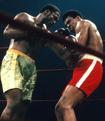 Joe Frazier corners Muhammad Ali during their WBC/WBA World