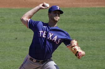 Cody earns 1st win, Texas hits 5 HRs, beats Angels 7-2
