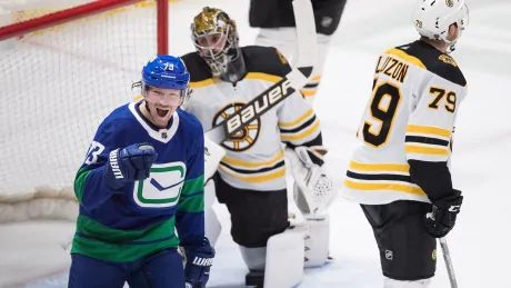 Toffoli nets pair as Canucks roll past Bruins with 9 goals
