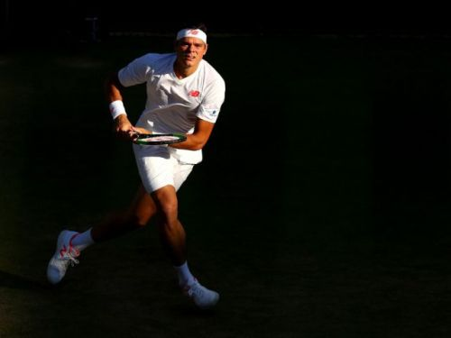 Milos Raonic's promising run at Wimbledon ends in quarter-finals with loss to John Isner