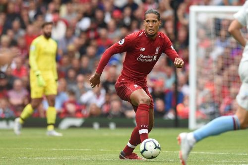 Van Dijk eyes silverware as Liverpool chase history