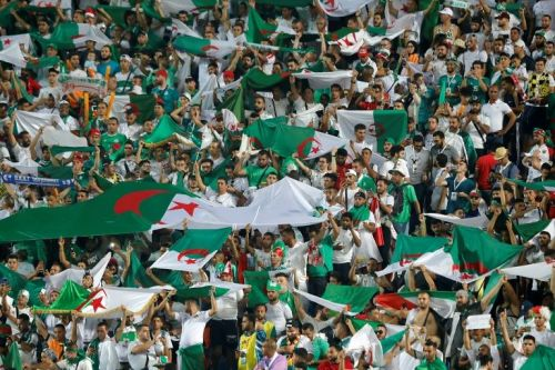 Algerian fans switch their Friday focus from politics to football