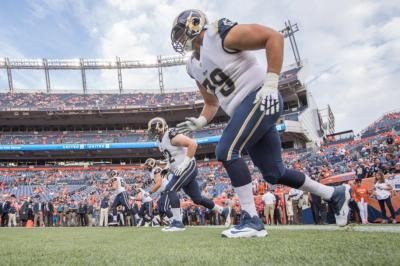 Rams lock in another starter with a contract extension as Aaron Donald's holdout continues