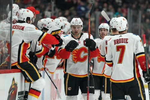 Tkachuk's goal in third period helps Flames clamp down on Wild