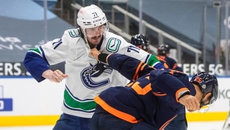 Canucks forward Zack MacEwen suspended 1 game for kneeing Oilers' Nurse