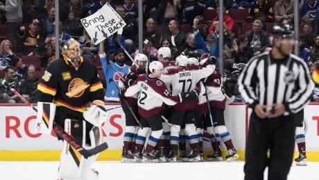 MacKinnon scores OT winner to lift Avs over Canucks