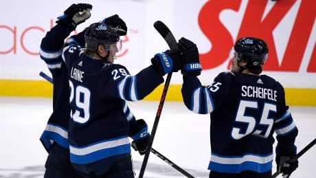Connor, Laine lead Jets to shootout win over Oilers