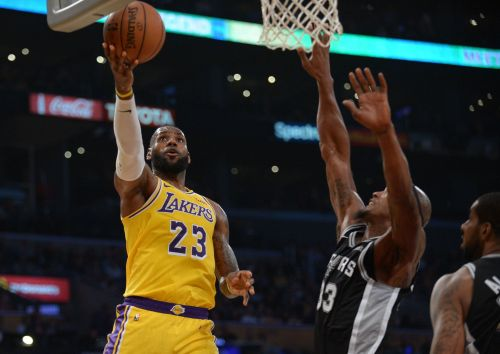 Lakers' chance for first win with LeBron James slips away in overtime as they fall to 0-3