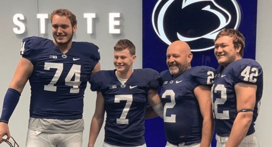 Photos: Dads dressing up in full uniform with their kids on recruiting visits is now officially a thing