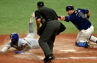 Adolis Garcia denied of two home runs on the same play in Rangers' 5-1 win over Rays