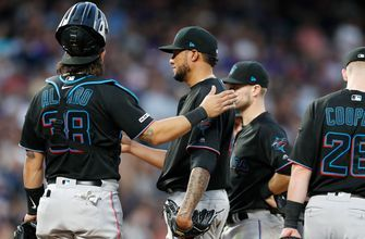 Marlins can't match Rockies' late push, fall 11-4 at Coors Field