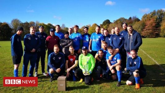 Football team for grieving dads wins top award