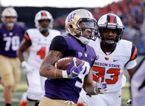 No. 17 Washington builds big lead, beats Oregon State 42-23
