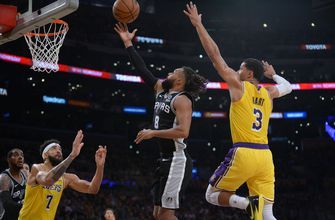 PHOTOS: Mills, Spurs keep LeBron James and the Lakers winless with overtime victory