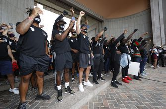 Broncos players, coaches join Floyd demonstration in Denver