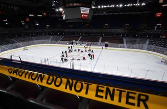 Pucks and masks prevalent as 24 NHL teams open training camp