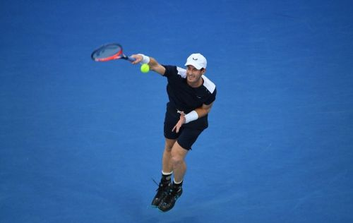 Battling Murray crashes out as Federer, Nadal fight on