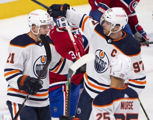 Canadiens clinch playoff spot with single point, fall to McDavid and Oilers in OT