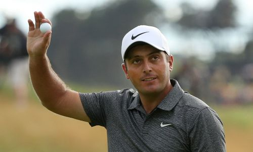 Molinari survives wild day to win British Open