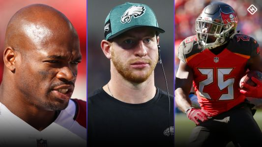 Fantasy Football Updates: Adrian Peterson signs, Carson Wentz injury update, Peyton Barber moves up rankings