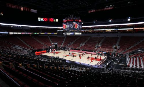 Louisville men's basketball game canceled, activities paused due to a positive COVID-19 test within program