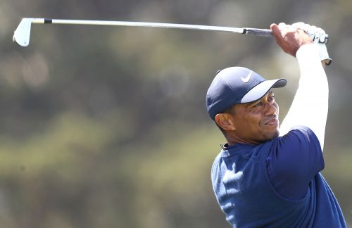 Tiger Woods backs up on moving day at PGA Championship