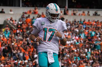 Dolphins QB Ryan Tannehill in shoulder pads at practice, but not throwing